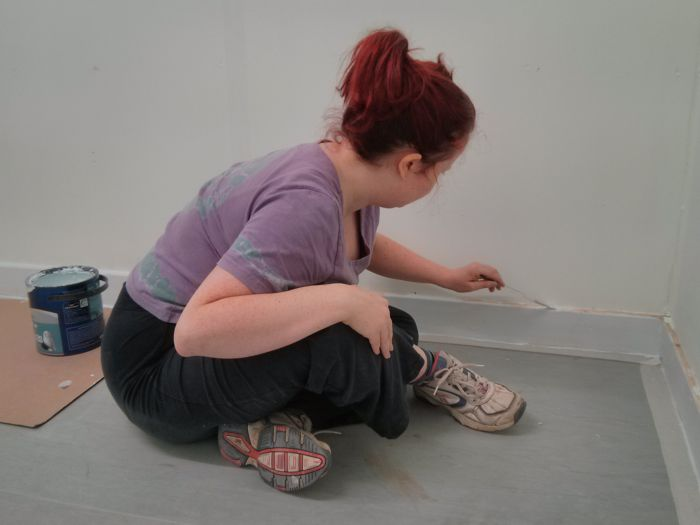 Laura painting skirting board