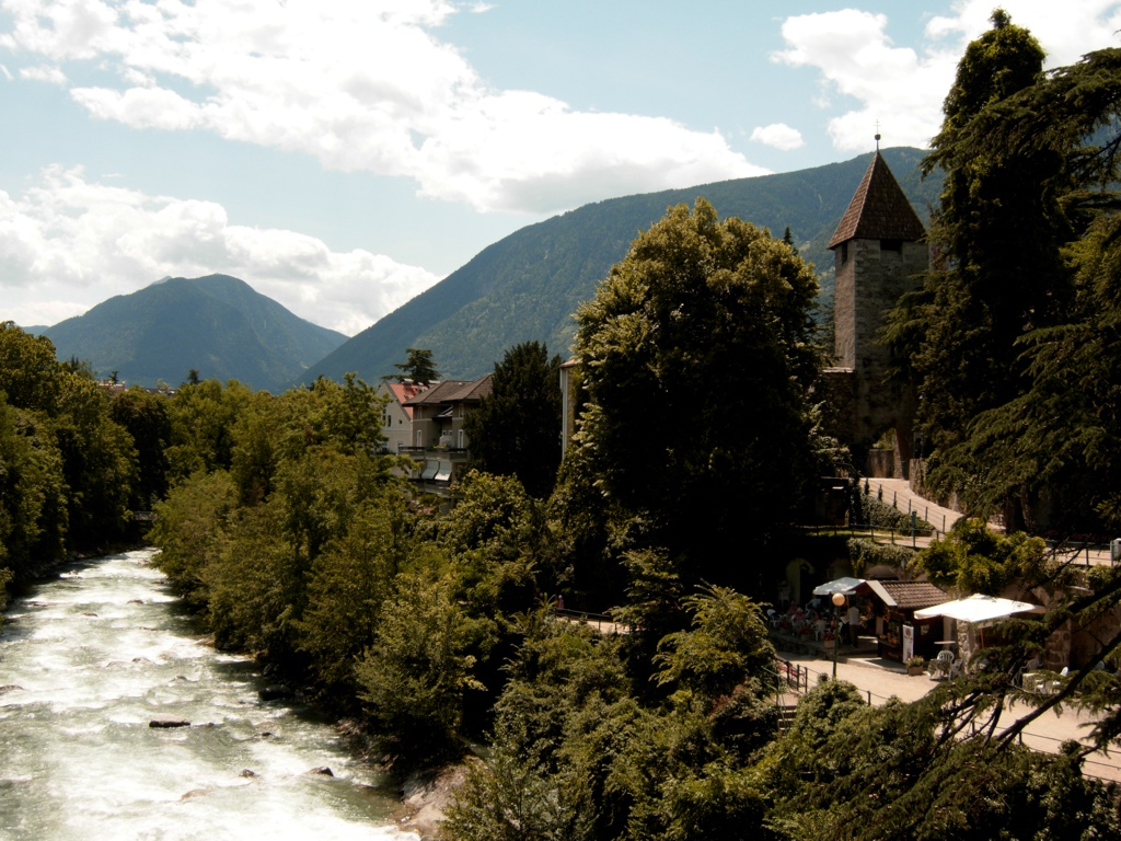 Merano (near the Austrian border) will surprise you for its stunning views, historic buildings and gardens.